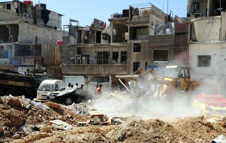 "A handout picture released by the Syrian Arab News Agency (SANA) on May 12, 2012, shows  workers removing the debris following twin suicide bombings in Damascus that killed 55 people on May 10. Al-Nusra Front, an Islamist group unknown before the Syrian revolt, released a video claiming responsibility for twin suicide bombings. AFP PHOTO/HO/SANA     == RESTRICTED TO EDITORIAL USE - MANDATORY CREDIT ""AFP PHOTO / HO / SANA"" - NO MARKETING NO ADVERTISING CAMPAIGNS - DISTRIBUTED AS A SERVICE TO CLIENTS ==HO/AFP/GettyImages"
